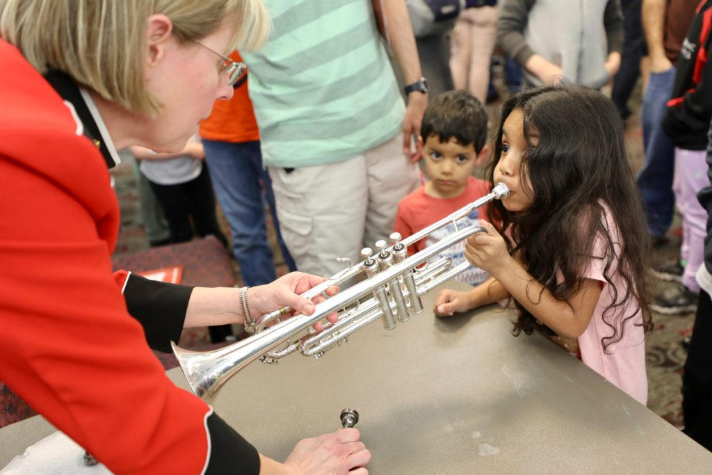 "On April 7, 2019, kids of all ages were swinging in their seats as ""The President's Own"" United States Marine Band demonstrated the incredible sound of big band music! A pre-concert performance offered the opportunity to sing along to songs and dance around, while afterward children got a closer look - and even got to play - the instruments they heard on stage. (U.S Marine Corps photo by Staff Sgt. Chase Baran/released)"